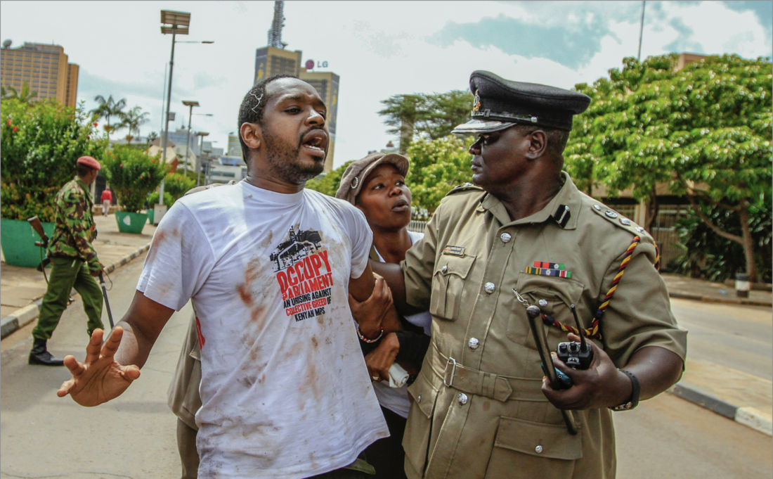 Government defends officers spotted soughing up Boniface Mwangi